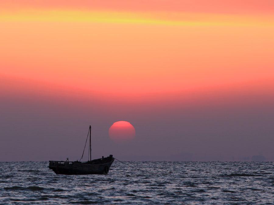 孤帆落日明
